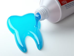 Toothpaste pours out of the tube into the shape of a tooth, reminding viewers of the importance of fluoride treatments in TX