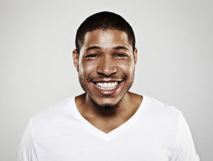 A man smiles, showing off his teeth after teeth whitening services in bellaire, tx