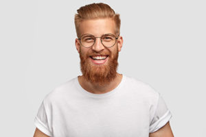 A man smiles happily after receiving specialty dentistry services in Bellaire, TX