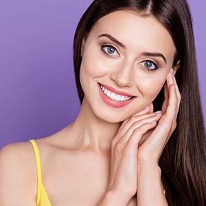 girl smiling after dental implants