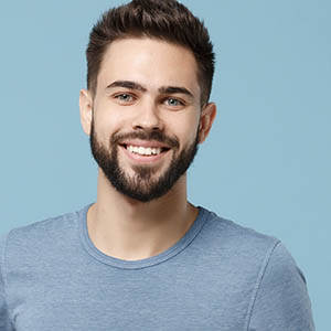 man smiling after dental appointment
