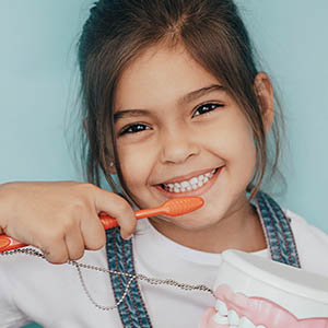 girl smiling after pediatric dentistry