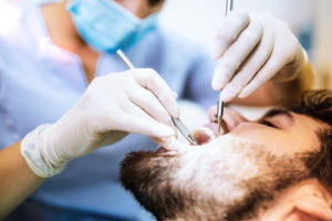 a doctor performing a tooth extraction